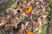 stock photo of buffet  - Closeup detail of grilled quails on display at an oriental restaurant buffet
