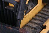 foto of bulldozer  - Closeup shot of an old toy bulldozer - JPG