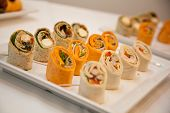 stock photo of catering  - mini wraps on a plate at an event - JPG