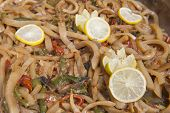 picture of buffet  - Closeup detail of calamari with vegetables on display at an oriental restaurant buffet - JPG