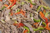 image of buffet  - Closeup detail of a beef shawarma dish on display at an oriental restaurant buffet - JPG