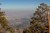 pic of smog  - View of The valley from the top of the San Jacinto Mountains in California with a very dense and thick smog layer - JPG
