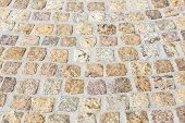 stock photo of paving stone  - Paving works with new beige granite stones - JPG