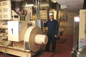 picture of generator  - A generator  in a hospital with a repair men - JPG