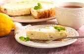 stock photo of cheesecake  - Lemon cheesecake with raisin and cup of tea - JPG