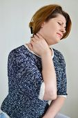 foto of neck brace  - Adult woman with neck pain on a light background - JPG