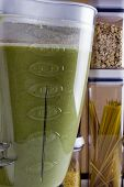 pic of blender  - Plastic container blender with green liquid mass - JPG