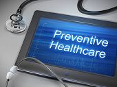 picture of stethoscope  - preventive healthcare words displayed on tablet with stethoscope over table - JPG