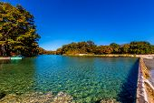 picture of crystal clear  - Blue Skies and Bright Beautiful Fall Foliage On The Crystal Clear Rocky Frio River at Garner State Park - JPG