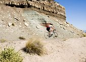 pic of semi-arid  - A biker rides through the scenery along the Rim Rock Drive in Colorado National Park - JPG
