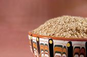pic of ceramic bowl  - Wheat bran in a ceramic bowl on the brown background - JPG