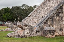 picture of serpent  - Serpent head stairway in El Castillo Pyramid Chichen Itza Mexico. ** Note: Shallow depth of field - JPG