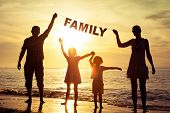 Постер, плакат: Happy Family Standing On The Beach