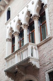 image of vicenza  - View of a balcony and columns of Cavalloni Thiene Palace in the historical Contr - JPG