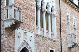 stock photo of vicenza  - View of a balcony and columns of Cavalloni Thiene Palace in the historical Contr - JPG