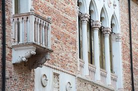 pic of vicenza  - View of a balcony and columns of Cavalloni Thiene Palace in the historical Contr - JPG