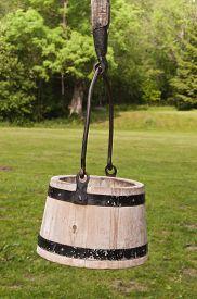 picture of shadoof  - Wooden bucket hanging on shadoof in old farmyard - JPG