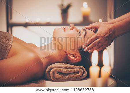 poster of Spa woman Massage. Face Massage in beauty spa salon. Female enjoying relaxing body and facial massag
