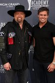 LAS VEGAS - APR 3:  Montgomery Gentry arrives at the Academy of Country Music Awards 2011 at MGM Grand Garden Arena on April 3, 2010 in Las Vegas, NV.