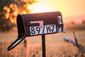 Old Mailbox In Rural Sunset poster