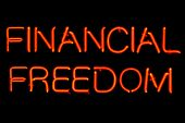 Red neon sign of the words 'Financial Freedom' on a black background.