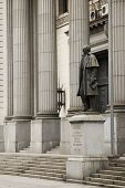 Detail shot of the national bank building in Montevideo, Uruguay, with the statue of Gen. Artigas in front of it. 2008
