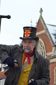 ROCHESTER CITY, KENT, ENGLAND - DEC 11: Unidentified English actor plays part of lamplighter on Dece