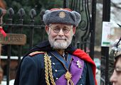 ROCHESTER CITY, KENT, ENGLAND - DEC 11: Unidentified gentleman dresses in old military uniform for annual Dickens Festival in Rochester on December 11, 2010.