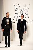 NEW YORK - FEBRUARY 11: Designers Brian Wolk and Claude Morais walks the runway for the Ruffian coll