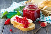 Homemade Jam. A Glass Jar With Red Currant Jam And White Bread On A Kitchen Wooden Table. Preserved poster