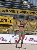 HUNTINGTON BEACH, CA. - MAY 23: Jen Kessy serving at the AVP Huntington Beach Open south of the pier
