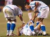 CARSON, CA. - JULY 3: Concacaf Gold Cup soccer match, Costa Rica vs. El Salvador at the Home Depot Center in Carson. Injuried player with team mates helping him up. July 3, 2009.