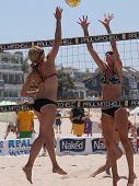 MANHATTAN BEACH, CA. - JULY 18: Chelsea Hayes spikes and Jenny Kropp attempts to block at the AVP Manhattan Beach Open on July 18, 2009 in Manhattan Beach, CA.