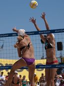 HERMOSA BEACH, CA. - AUGUST 8: Jen Kessy (L) and April Ross vs. Nicole Branagh and Elaine Youngs (R)