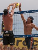 HERMOSA BEACH, CA. - AUGUST 9: Phil Dalhausser and Todd Rogers (R) vs. John Hyden and Sean Scott (L)