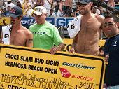 HERMOSA BEACH, CA. - AUGUST 9: Phil Dalhausser (R) Todd Rogers (L)  and representatives from Crocs a