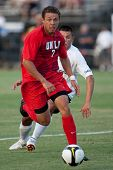 NORTHRIDGE, CA. - AUGUST 28: Nicholas DeLeon (L) dribbles away from Matthew Chavez (R) during the UNLV vs. CSUN pre-season exhibition on August 28, 2009 in Northridge, Ca.