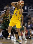 LOS ANGELES, CA. - SEPTEMBER 16: Swin Cash (L) defending against Tina Thompson (R) during the WNBA p