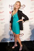 SANTA MONICA, CA. - FEB 22: Victoria's Secret model Erin Heatherton arrives at the Nomad Two Worlds Los Angeles debut gala at 59 Pier Studios West on Feb 22, 2011 in Santa Monica, CA.