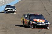 AVONDALE, AZ - NOV 7 - Juan Montoya (42) and Scott Riggs (66) compete in the NASCAR Sprint Cup Seriesat the Phoenix International Raceway on November 7, 2008 in Avondale, Arizona.