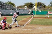MESA, AZ - NOV 20: Mark Trumbo of  the Scottsdale Scorpions hits with Mesa Solar Sox catcher Lou Marson behind the plate, in the Arizona Fall League game on November 20, 2008 in Mesa, Arizona