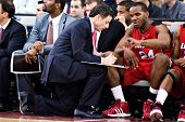 GLENDALE, AZ - DECEMBER 20: Coach Rick Pitino of the Louisville Cardinals outlines a play for Samard