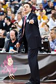 GLENDALE, AZ - DECEMBER 20: Louisville head coach Rick Pitino gestures during the game with Minnesot