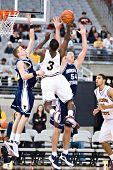 GLENDALE, AZ - DECEMBER 20: Ty Abbott #3 of Arizona State Univerity shoots over Chris Miles #54 and
