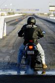 CHANDLER, AZ - APRIL 25: A motorcycle competes on the drag strip at Firebird International Raceway o