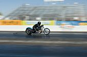 CHANDLER, AZ - OCTOBER 1: A motorcycle competes in the NHRA Pacific Division drag racing championship on October 1, 2009 in Chandler, Arizona.
