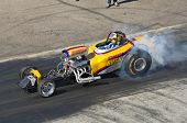 CHANDLER, AZ - OCTOBER 2: A dragster burns out before the start of the race in the NHRA Pacific Divi