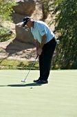 SCOTTSDALE, AZ - OCTOBER 21: Tom Lehman putts in the Frys.com Open PGA golf tournament on October 21