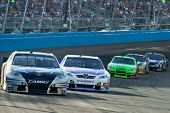AVONDALE, AZ - APRIL 10: Scott Speed (#82) leads a line of cars during a yellow caution flag at the
