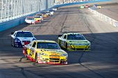 AVONDALE, AZ - APRIL 10: Clint Bowyer (#33) leads a group of cars into turn one at the Subway Fresh